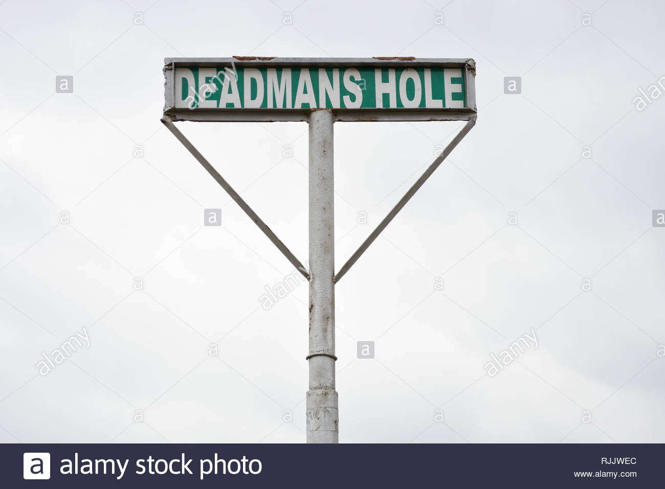 Deadmans Hole Sign. Sign for Deadmans Hole or Dead Mans Hole near Marble Falls Texas. Dead Mans Hole Texas Hill Country. Road Name Sign. Road Sign TX - Stock Image