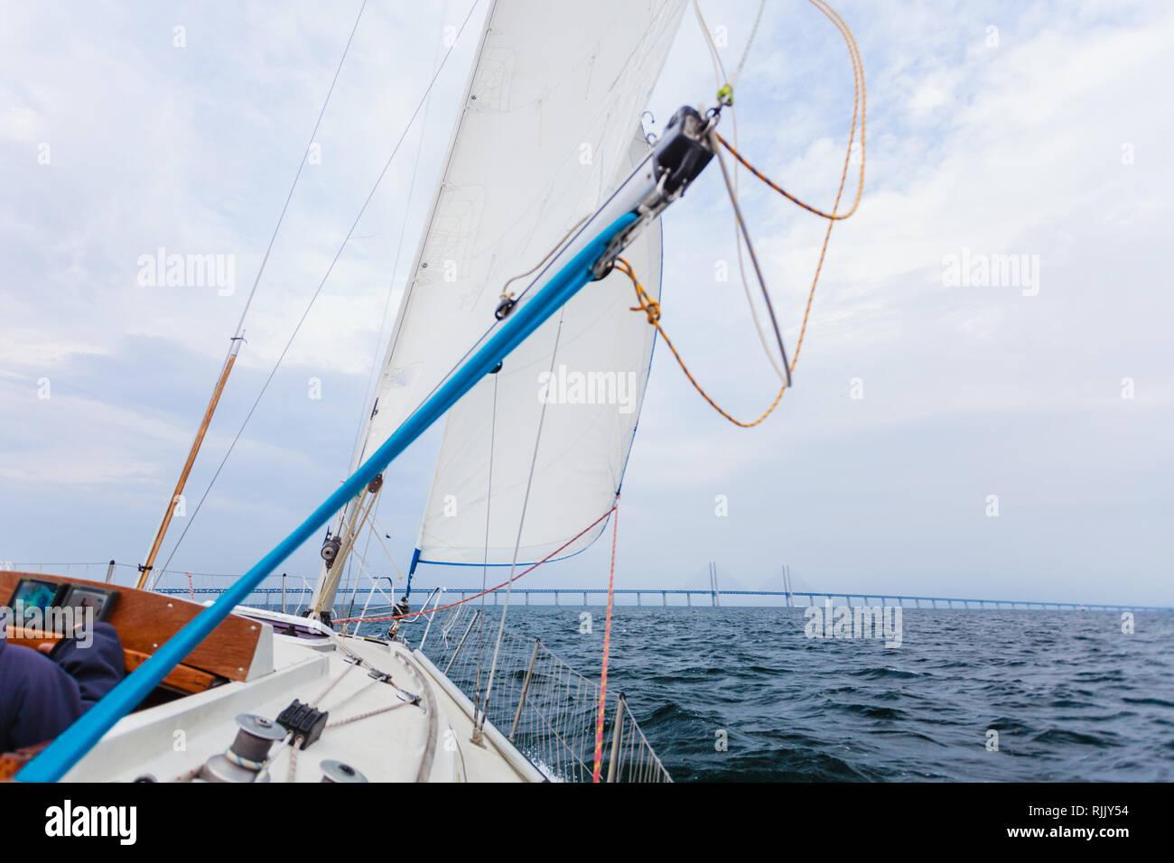 Oresundsbron. The Oresund bridge link between Denmark and Sweden, Europe, Baltic Sea. View from sailboat yacht. Overcast sky. Landmark and travel. Stock Photo