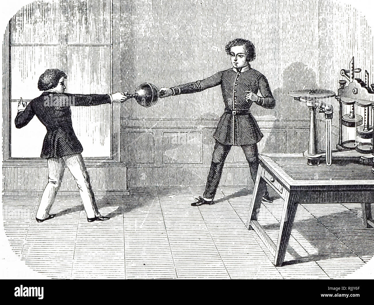 An engraving depicting two boys trying to pull apart two Magdeburg hemispheres from which the air has been evacuated by the air pump, right. Dated 19th century - Stock Image
