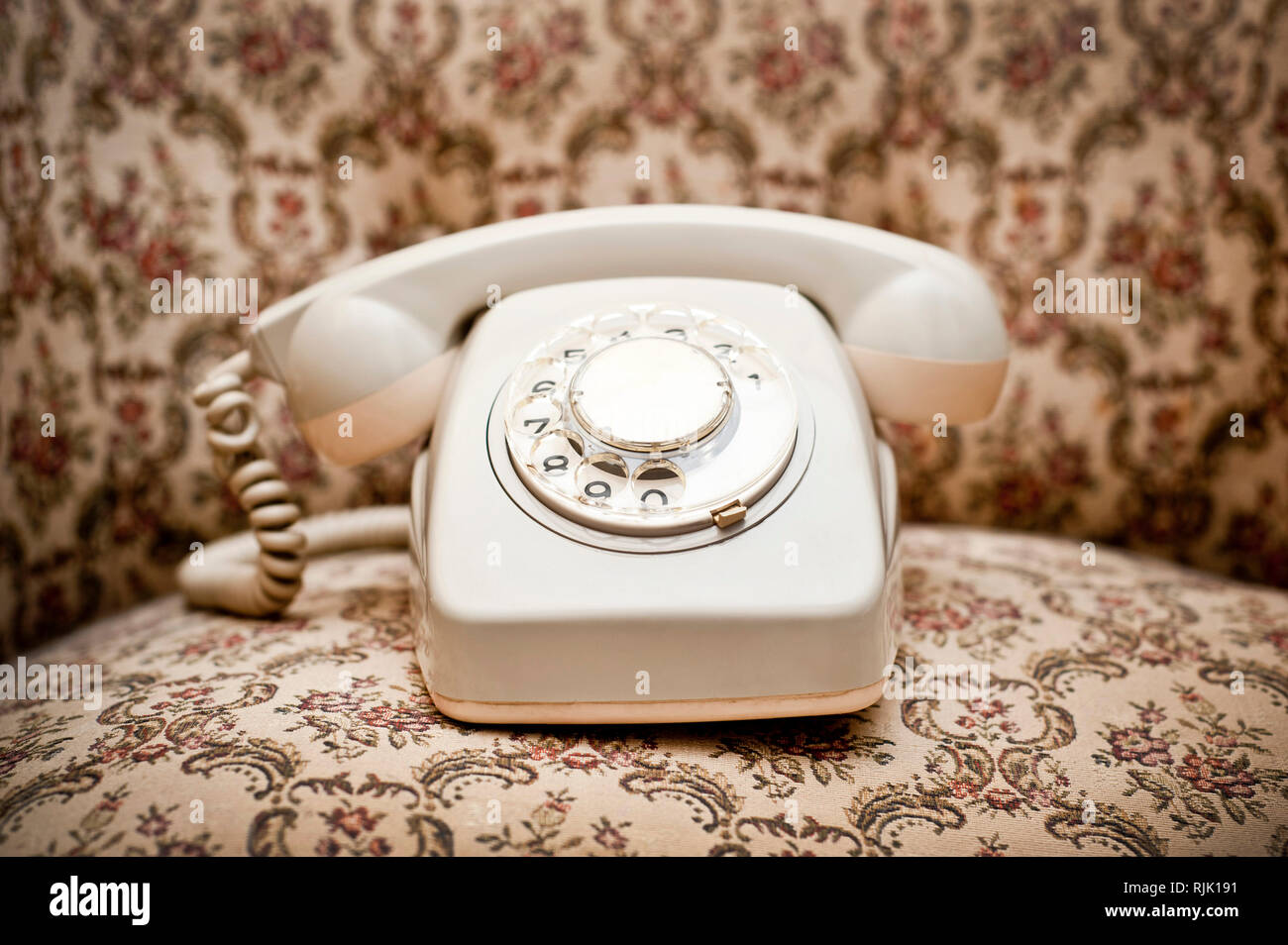 a retro rotary dial telephone - Stock Image