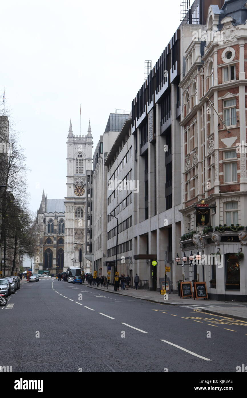 Looking up the street to Westminster Abbey in London - Stock Image