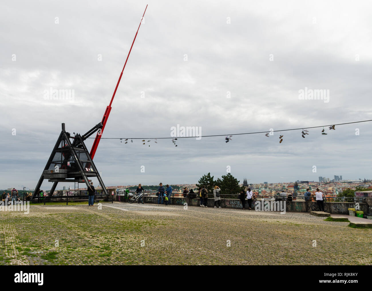 Shoes hanging on a wire by the Metronome, Prague, Czech Republic - Stock Image