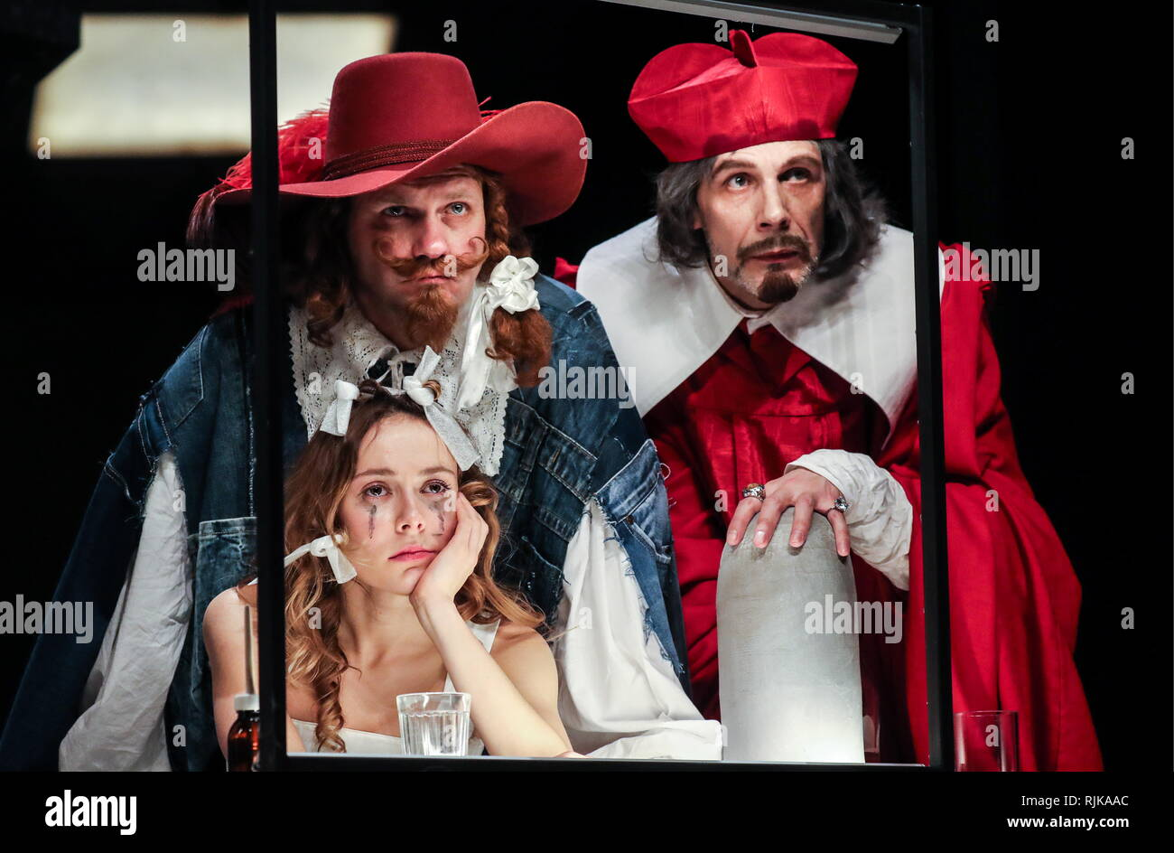 Moscow, Russia. 06th Feb, 2019. MOSCOW, RUSSIA - FEBRUARY 6, 2019: Actors Polina Pakhomova (front) as Constance, Oleg Feoktistov as Porthos and Oleg Plaksin (L-R background) as Cardinal Richelieu in a scene from the Dyuma production based on a play by Ivan Okhlobystin and staged by Mikhail Yefremov at Sovremennik Theatre. Vyacheslav Prokofyev/TASS Credit: ITAR-TASS News Agency/Alamy Live News - Stock Image