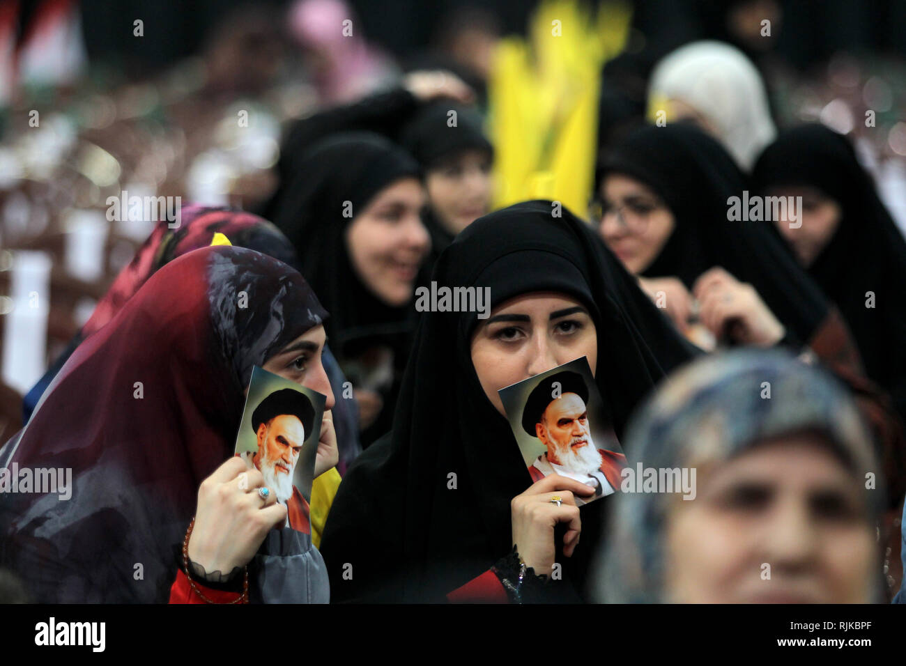 06 February 2019, Lebanon, Beirut: Supporters of Hezbollah, the pro-Iranian Lebanese Islamist political party and militant group, hold pictures of Ayatollah Khomeini, former Supreme Leader of Iran and leader of the 1979 Iranian Revolution, during a rally to mark the 40th anniversary of the Iranian Islamic Revolution which toppled Mohammad Reza Pahlavi, the last Shah of Iran. Photo: Marwan Naamani/dpa - Stock Image