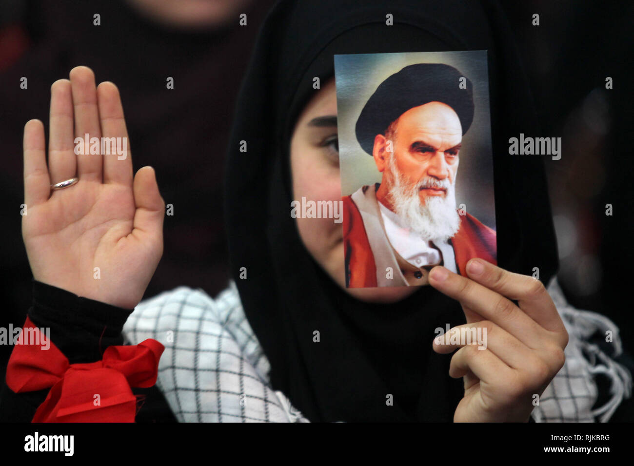 06 February 2019, Lebanon, Beirut: A supporter of Hezbollah, the pro-Iranian Lebanese Islamist political party and militant group, holds a picture of Ayatollah Khomeini, former Supreme Leader of Iran and leader of the 1979 Iranian Revolution, during a rally to mark the 40th anniversary of the Iranian Islamic Revolution which toppled Mohammad Reza Pahlavi, the last Shah of Iran. Photo: Marwan Naamani/dpa - Stock Image
