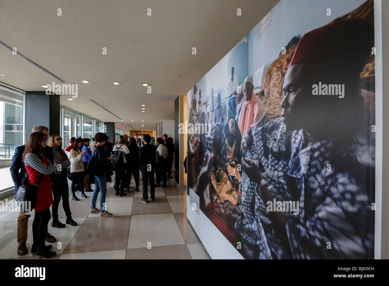 United Nations, United Nations headquarters in New York. 6th Feb, 2019. People look at photos at the photo exhibition of 'The 68 Million Girls at Risk' on the occasion of the International Day of Zero Tolerance for Female Genital Mutilation, at the United Nations headquarters in New York, Feb. 6, 2019. Three executive directors of the UN agencies on Wednesday called for actions to eliminate female genital mutilation by 2030 on the International Day of Zero Tolerance for Female Genital Mutilation. Credit: Li Muzi/Xinhua/Alamy Live News - Stock Image