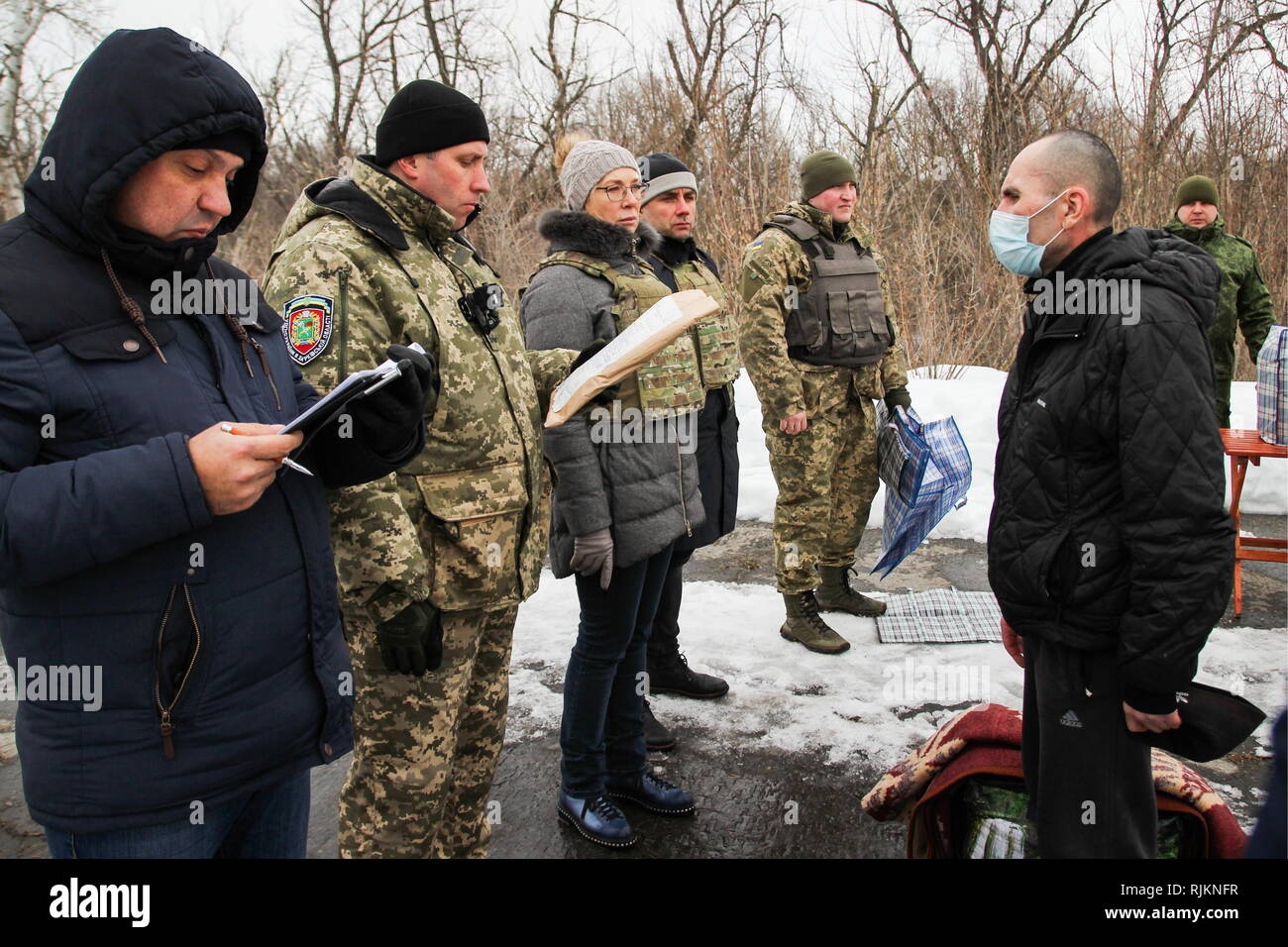 Schastye, Ukraine. 07th Feb, 2019. LUGANSK REGION, UKRAINE - FEBRUARY 7, 2019: Ukrainian officials (L) during the handover of 33 people who were convicted in east Ukraine before 2014 and who want to serve their terms outside Donbass, by the Lugansk People's Republic to the Kiev authorities. Alexander Reka/TASS Credit: ITAR-TASS News Agency/Alamy Live News - Stock Image