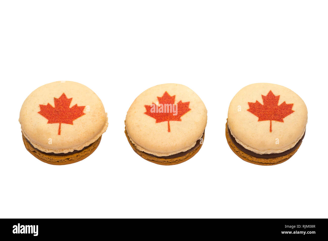 Macaron decorated with red maple leaves for Canada Day - Stock Image