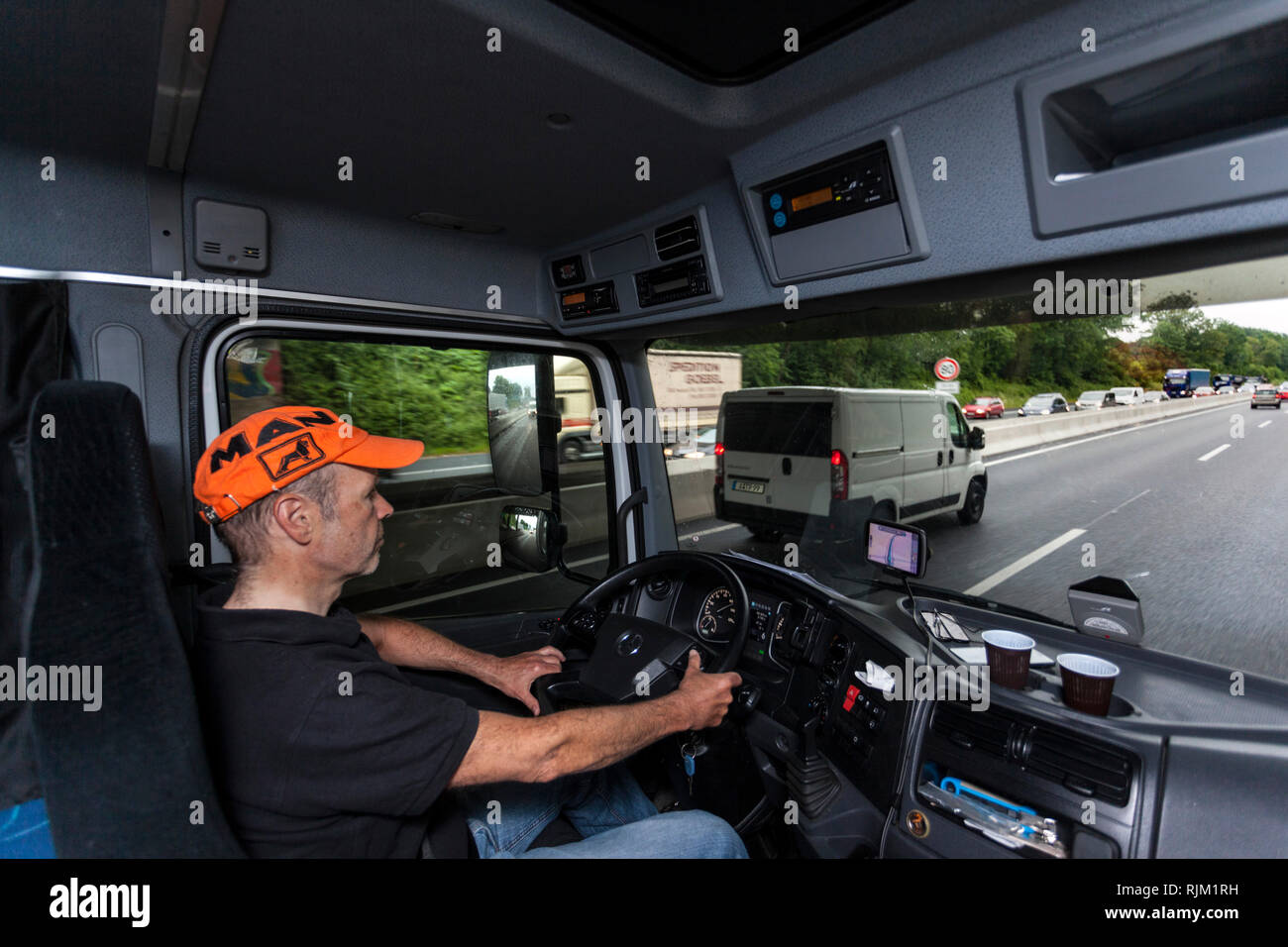 Driver in his truck during his tour - Stock Image