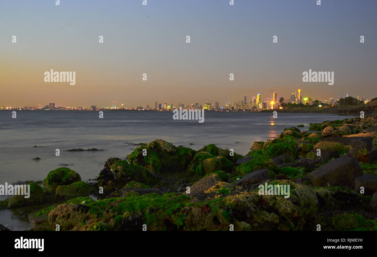 Melbourne skyline during blue hour at night time, view from St.Kilda with a long time exposure - Stock Image