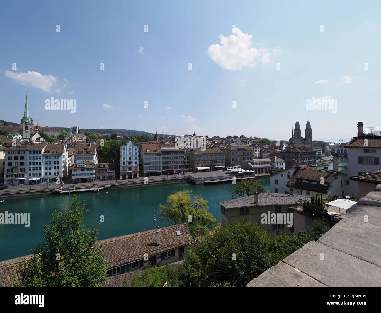 View of european Zurich city in Switzerland with houses on bank of Limmat river - Stock Image