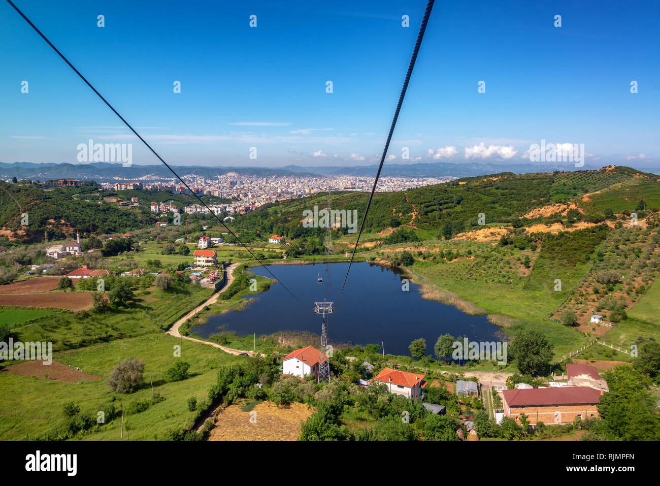 Rural landscape with Tirana, Albania in the background - Stock Image