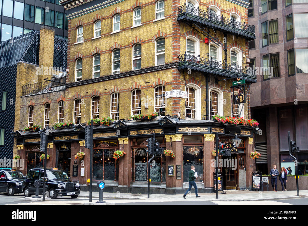 United Kingdom Great Britain England London Westminster The Albert Pub Victorian public house building exterior brick building black taxicab taxi hack - Stock Image