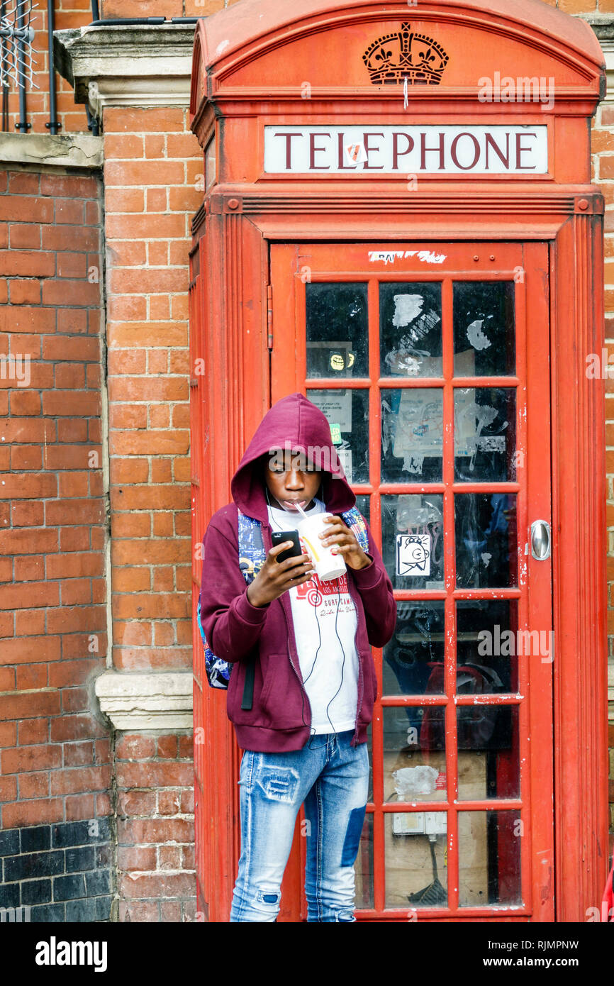 United Kingdom Great Britain England London Lambeth South Bank red telephone box telephone kiosk public phone designed by Giles Gilbert British cultur - Stock Image