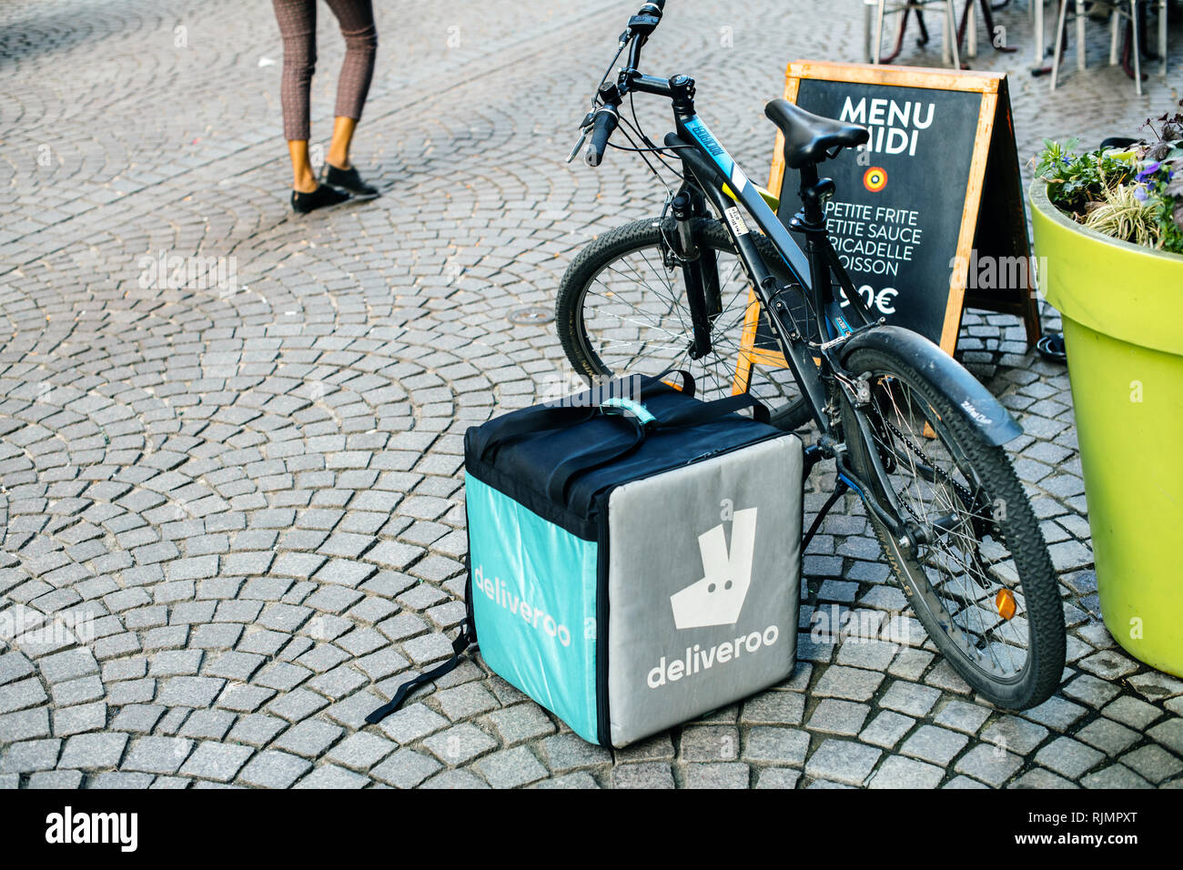 STRASBOURG, FRANCE - APR 3, 2017: Deliveroo bike and isothermic food delivery cargo box parked in city near cafe restaurant area  - Stock Image