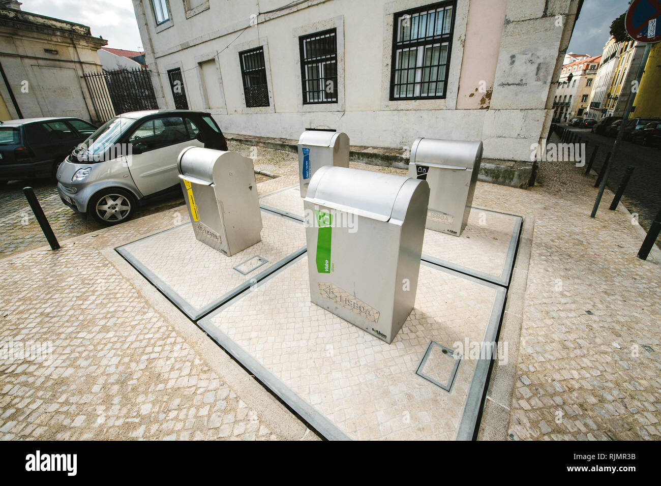 LISBON, PORTUGAL - FEB 10, 2018: View of separate waste containers with underground system on city street for glass, plastic, paper, metal Stock Photo