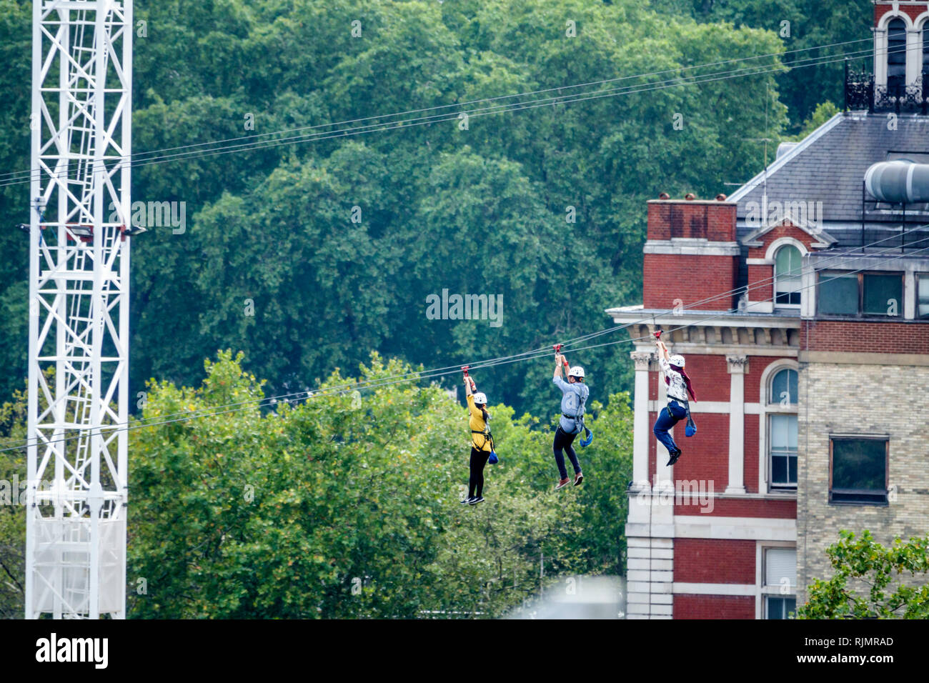 London England United Kingdom Great Britain South Bank Lambeth urban zip wire zip line man woman - Stock Image
