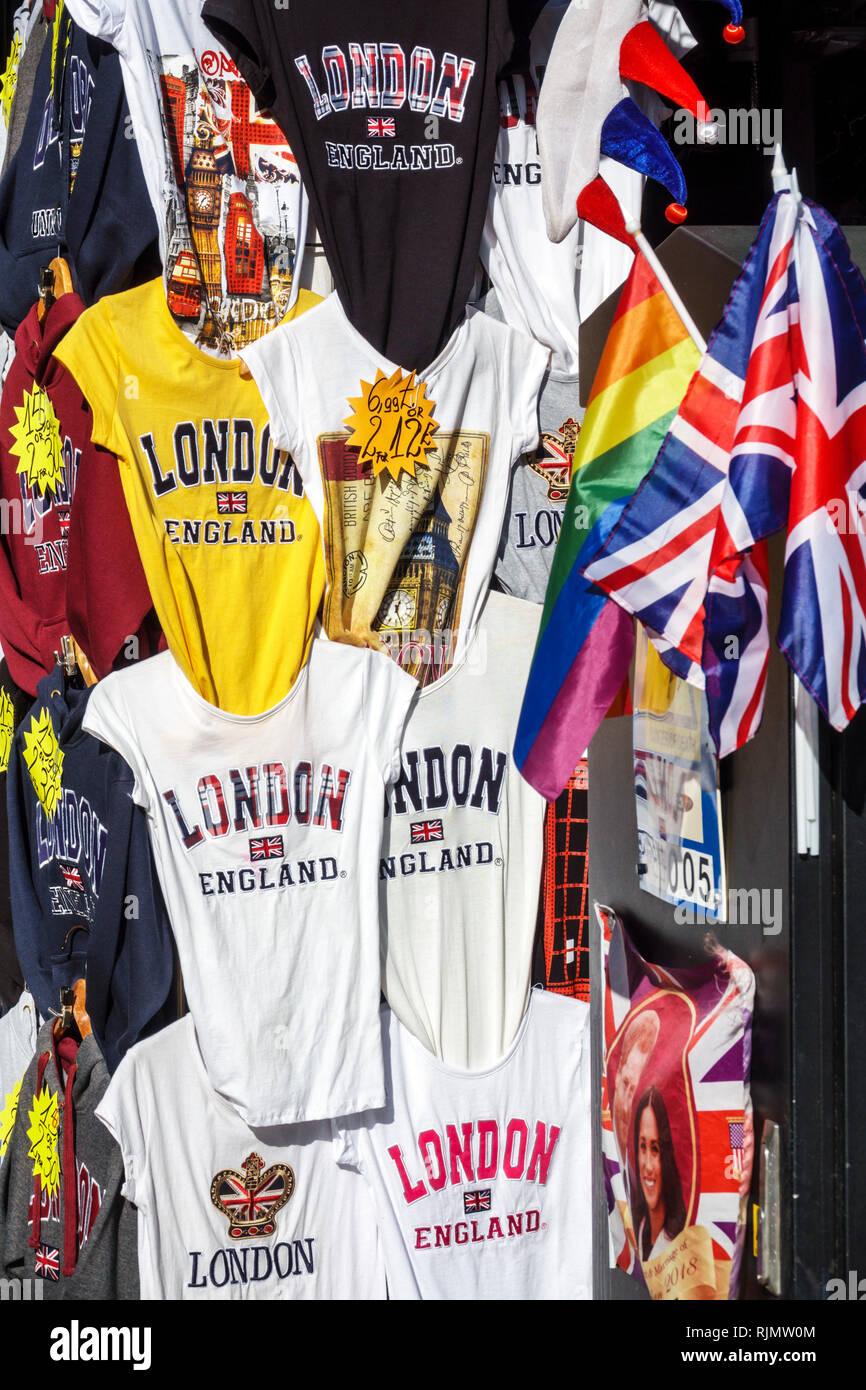 London England United Kingdom Great Britain West End Piccadilly street vendor souvenir kiosk shopping tee shirt t-shirt Union Jack flag display sale - Stock Image