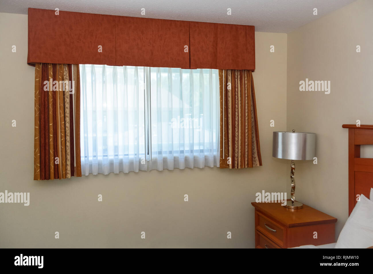 Window With The Curtains And Bedside Table In The Corner Of The Room Stock Photo Alamy