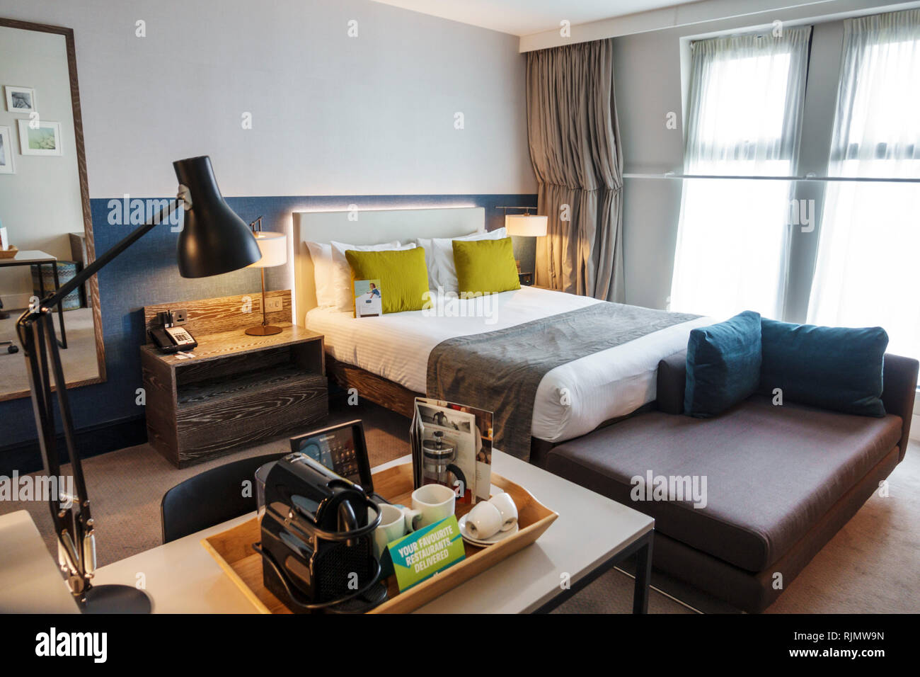 London England United Kingdom Great Britain Lambeth Staybridge Suites London Vauxhall hotel guest room bed desk clean room coffee maker tray contempor - Stock Image