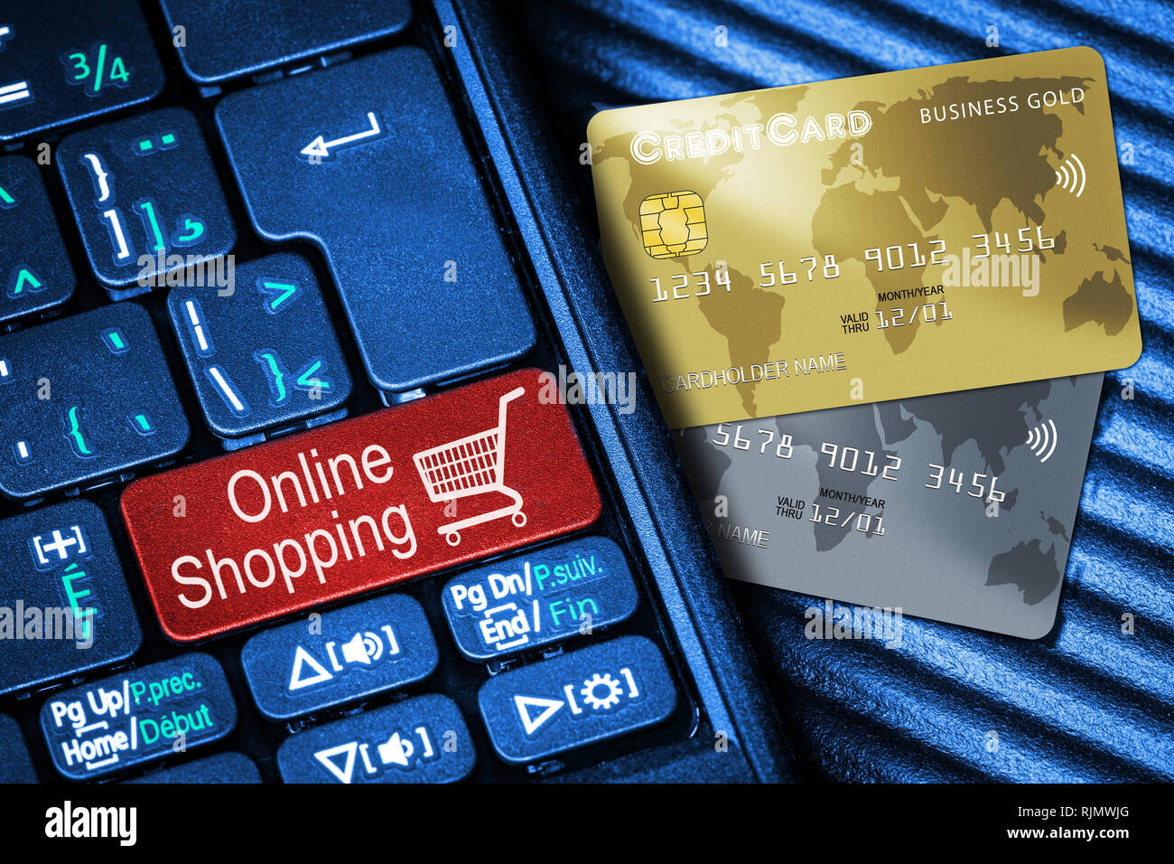 Close up of computer laptop keyboard on generic credit cards with red button Online Shopping concept. Idea of Internet shopping and data privacy, secu - Stock Image