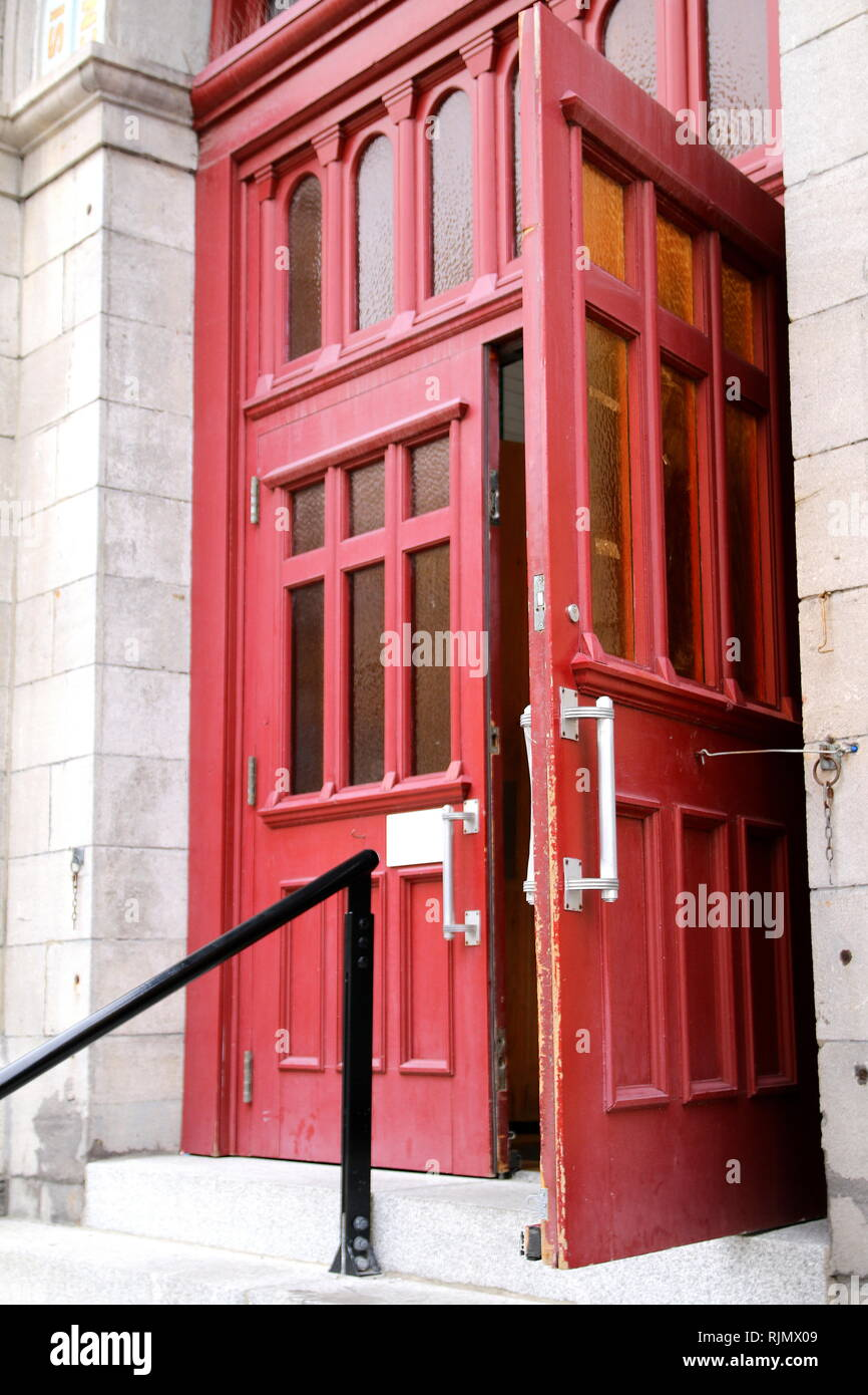 The red doors are at the entrance to this museum. - Stock Image