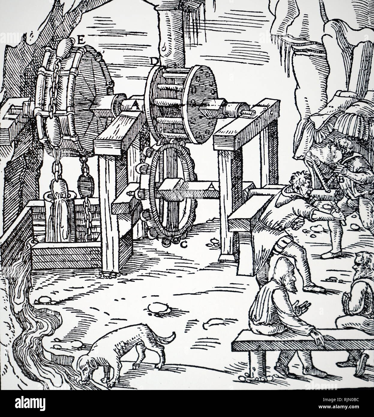 Illustration showing, Multiple suction pumps, powered by an overshot water wheel through a toothed wheel and drum (C,D,E) being used to raise water from a mine. From Agricola 'De re metallica', Basle, 1556 - Stock Image