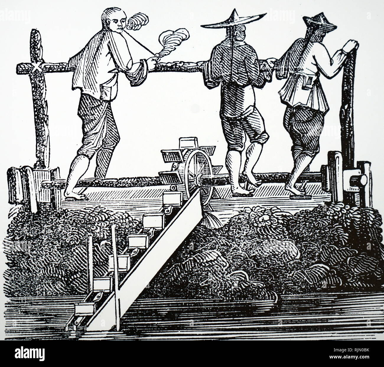 Mine drainage illustration: Man in centre left of picture is boring lengths of wood with borers and augers to form pipes. Man on centre right is working the piston rod of a suction pump to rais e water from a mine (water is running out of pipe, G).In the left foreground are lengths of pipe to be joined, and various internal pump parts. From Agricola 'De re metallica', Basle, 1556 - Stock Image