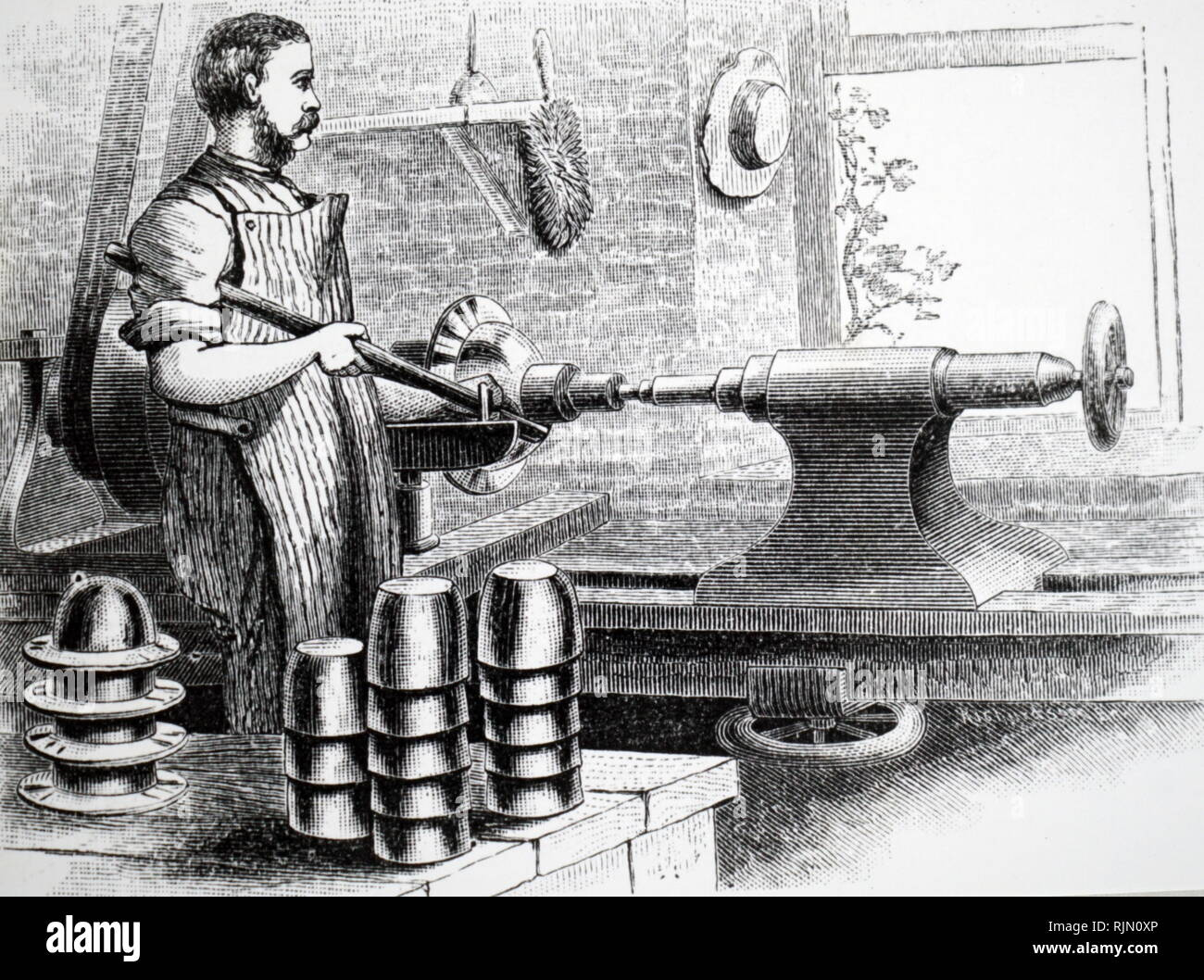 Illustration showing SPINNING METAL: method used to produce hollow-ware such as teapots, dish covers, powder horns, 1880 - Stock Image