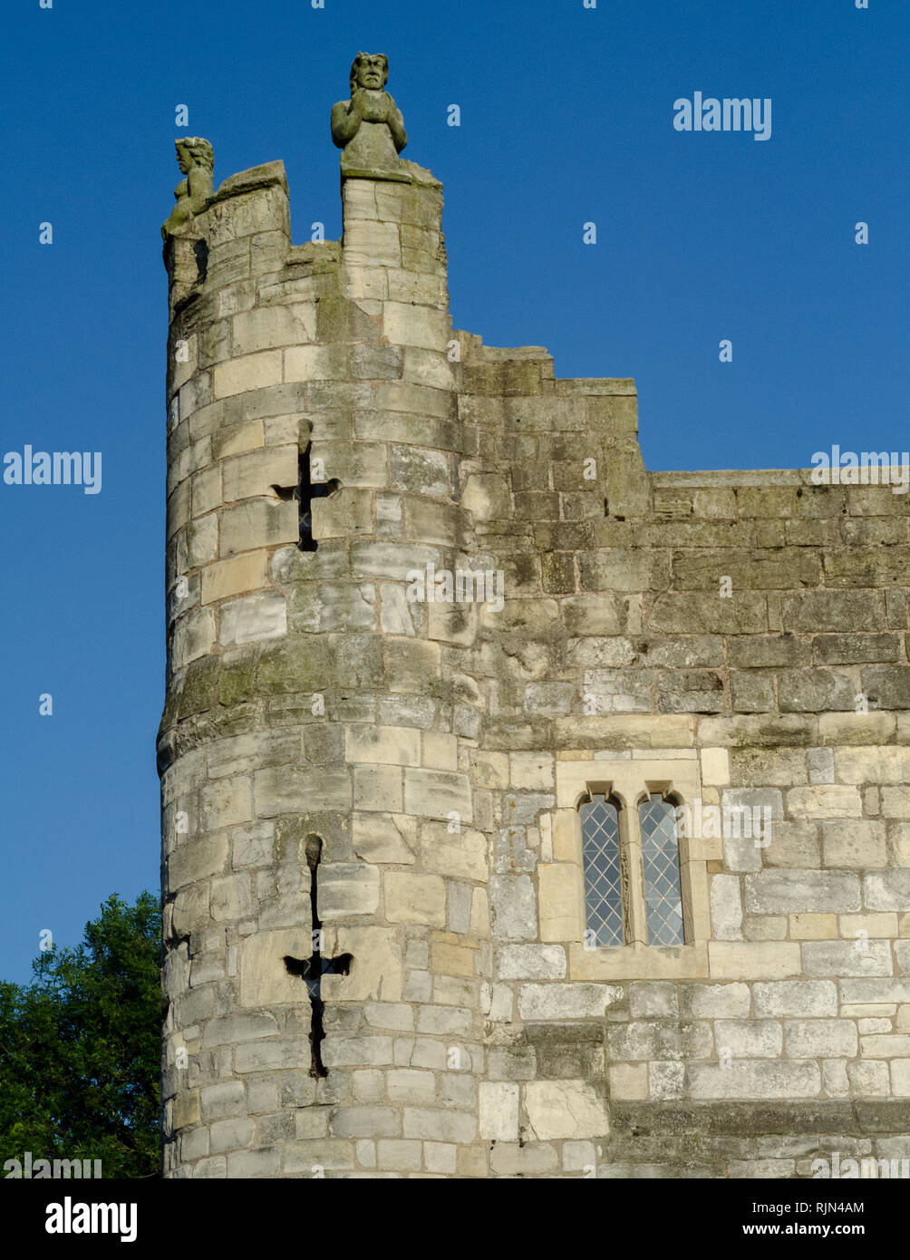 A gatehouse in the walled fortifications in York, England. Arrowslits are visible which provided defense against intruders. - Stock Image
