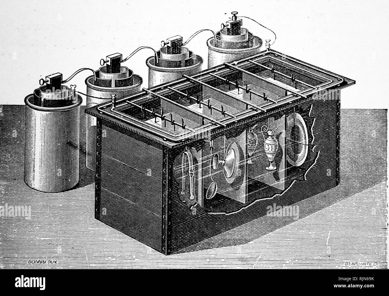 Illustration showing Electroplating bath with part of the side cut away to show arrangement of items to be silver plated 1904 - Stock Image