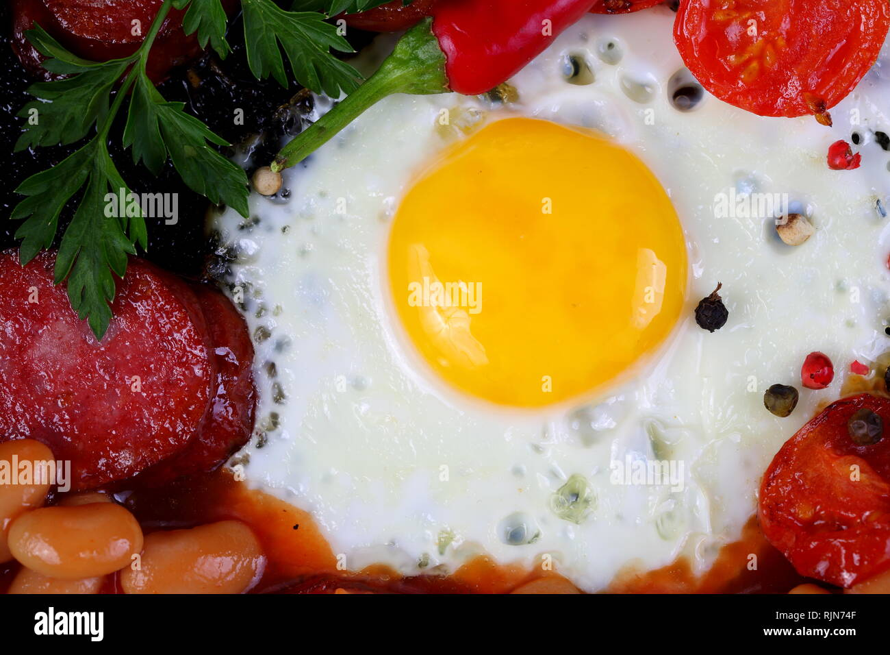 Still life with scrambled eggs and sausage Stock Photo