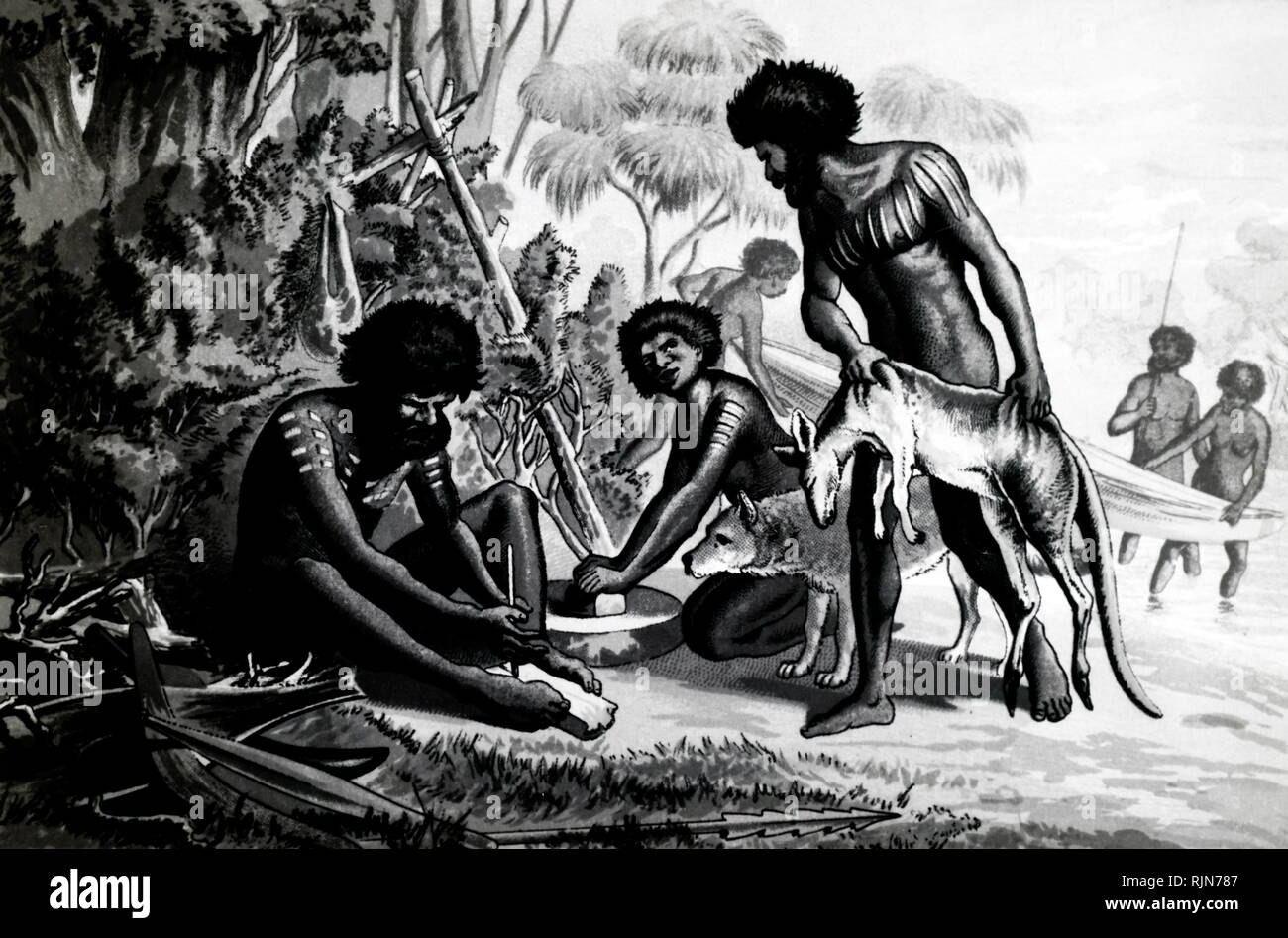 Illustration showing Australian aborigines preparing a meal beside a river. The man on the left is making fire by rubbing softwood core with hardwood stick (blister method). With them is their hunting dog (Dingo?). - Stock Image