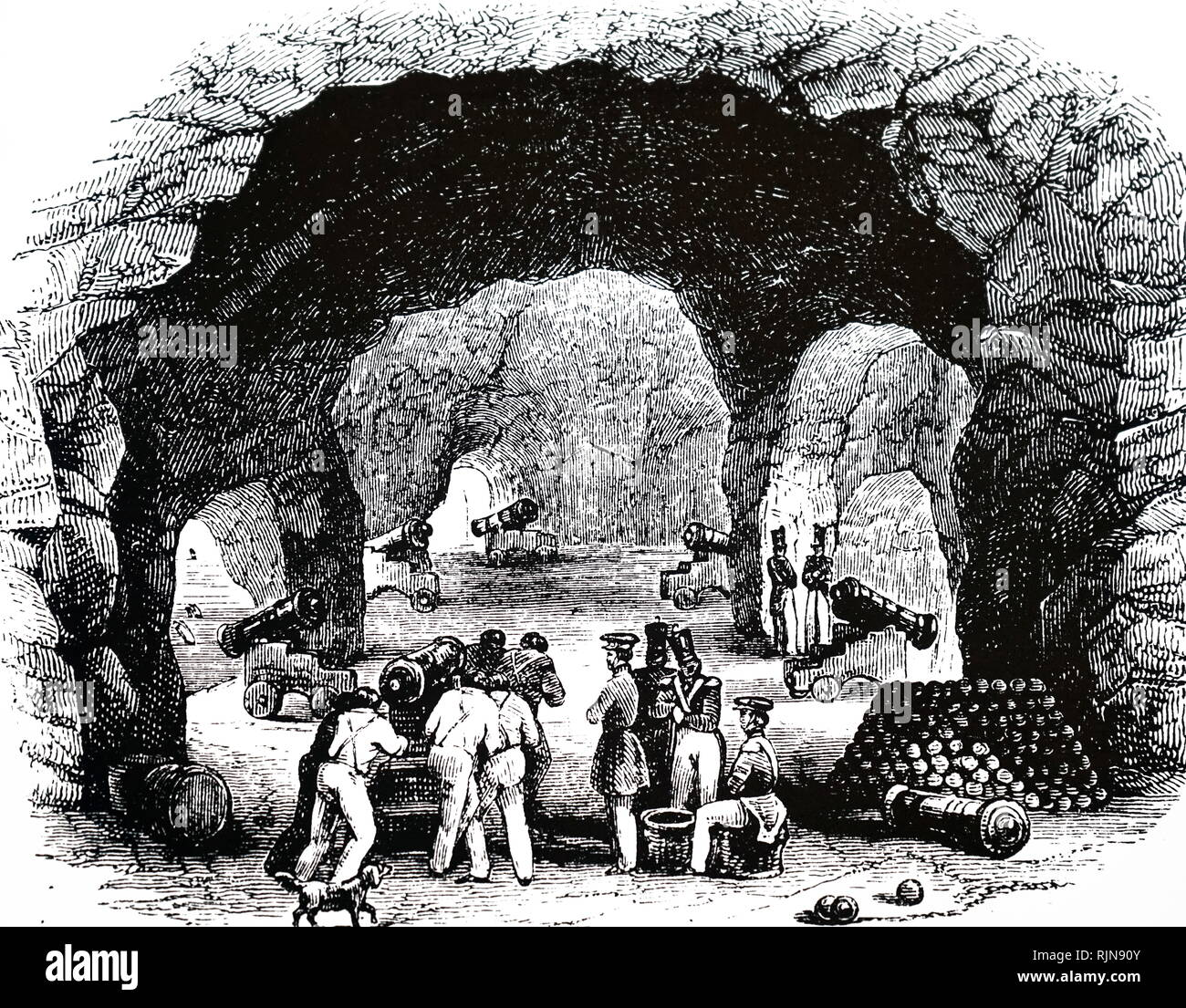 An engraving depicting St. George's Hall, Gibraltar, excavated from solid rock, this gallery could hold several hundred men, and had heavy guns pointing in various directions. Dated 19th century - Stock Image