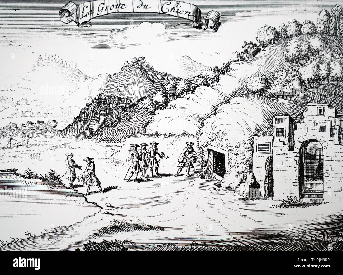 An engraving depicting the guide of the Grotto de Cane, demonstrating the dangers of suffocating in the grotto. The guide would hold his dog in the fumes until it was almost unconscious. He would then throw it into the lake and revive it. Dated 18th century - Stock Image