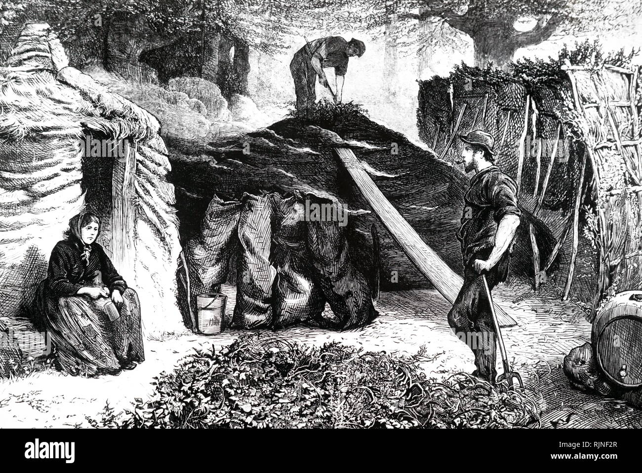 An engraving depicting charcoal burners in Epping Forest. They spent the summer in huts in the forest to be on hand to attend the fires whenever necessary. - Stock Image