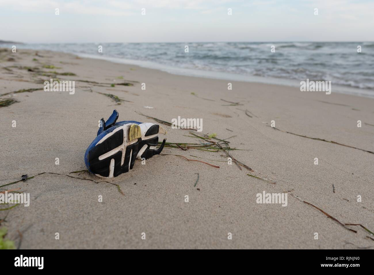 Shoe on the beach - Stock Image