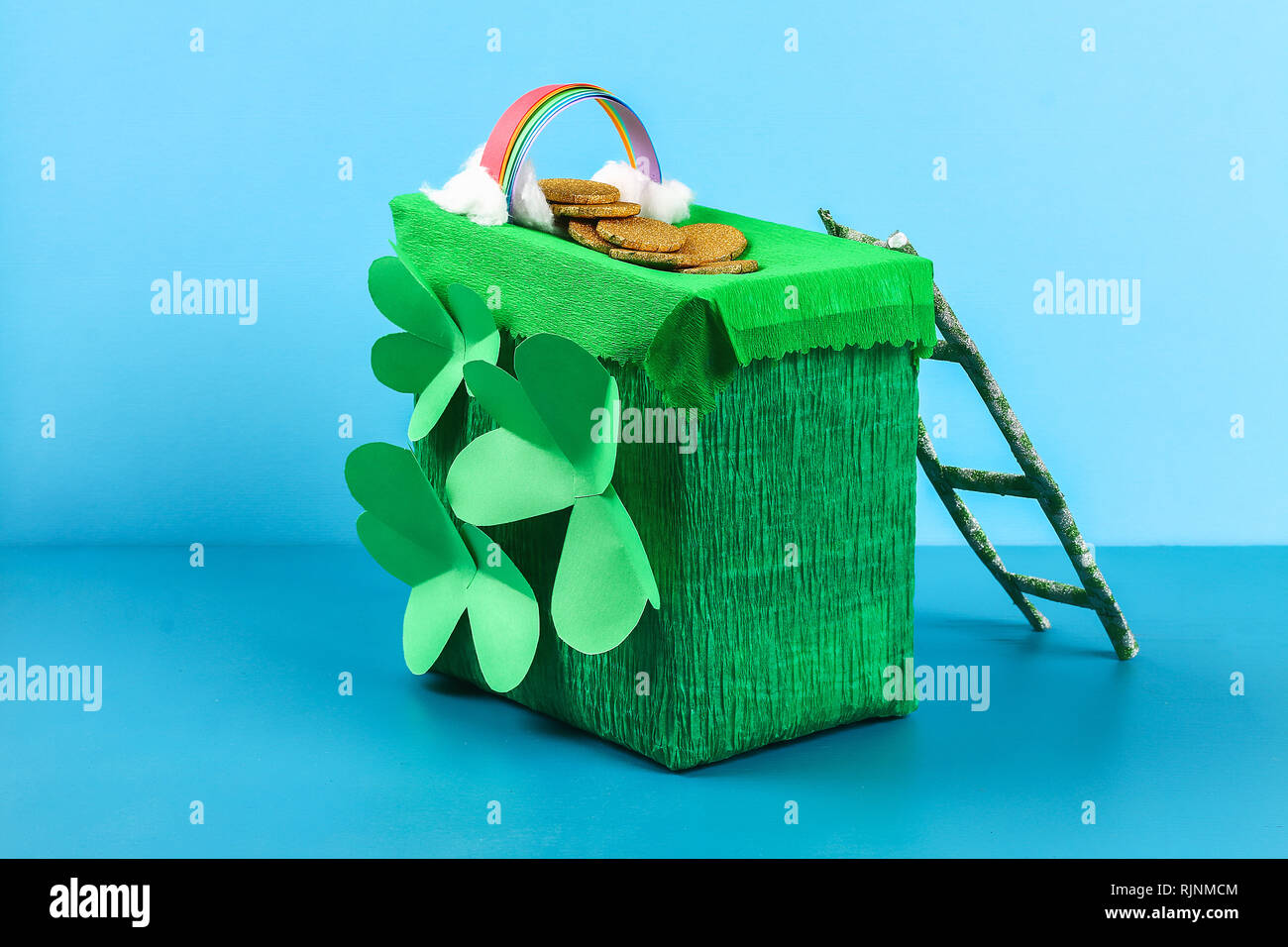 795b33862 DIY leprechaun trap with gold coins, rainbow and green ladder St Patricks  Day background. Gift Idea, decor Saint Patricks Day. Step by step. Child kid