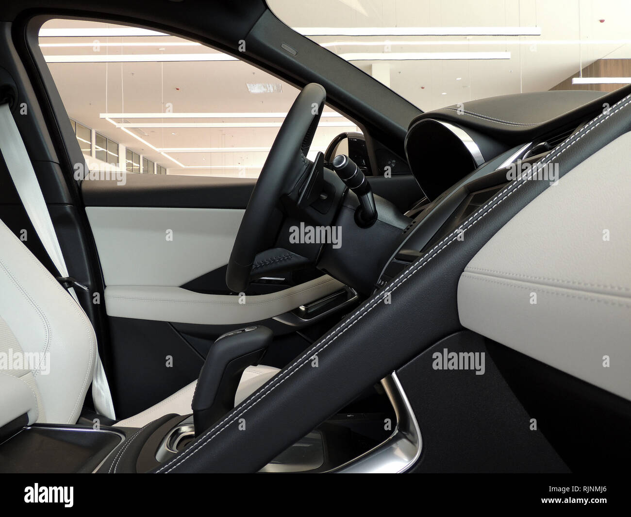 Combination of black and white leather upholstery of premium car interior Stock Photo