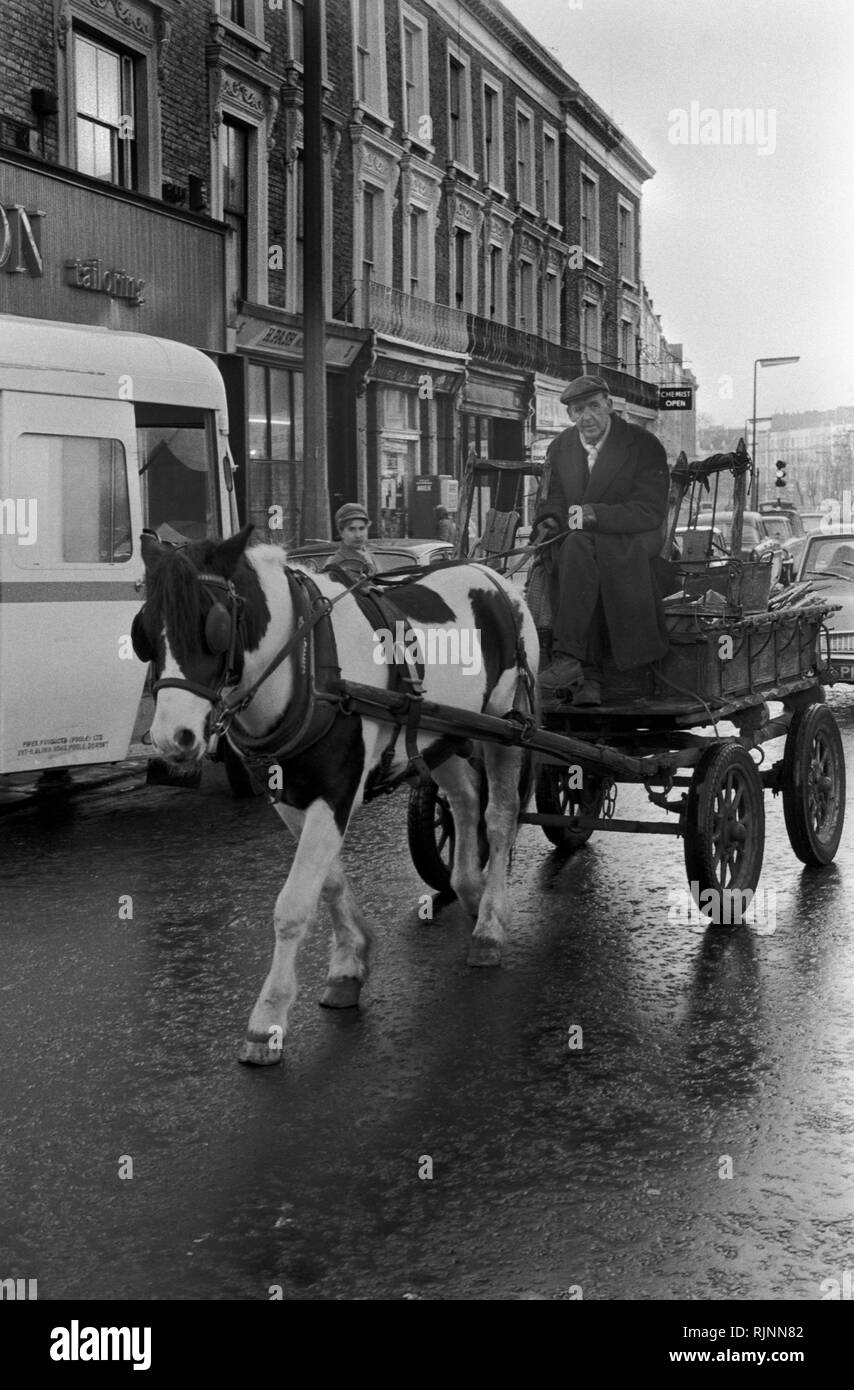 Rag and Bone man also called a Totter  collecting scrap metal and stuff to sell with his horse and cart, Notting Hill area of West London 1970.Collecting scrap for recycling re-cycling 1970s UK. HOMER SYKES - Stock Image