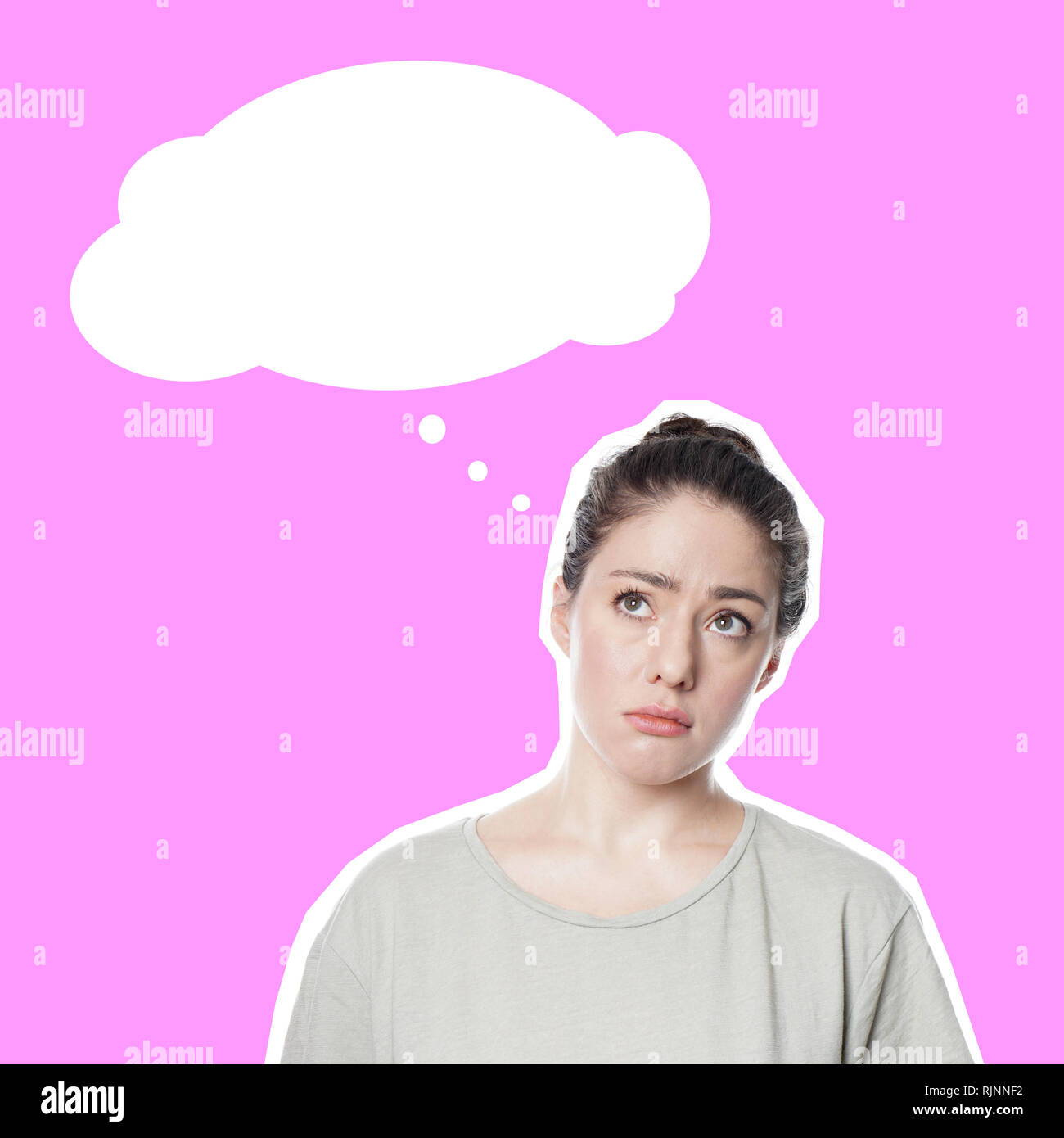 worried thoughtful young woman with concerned look on her face contemplating idea or problem - comic style cut out on pink background - empty thought bubble with copy space. - Stock Image