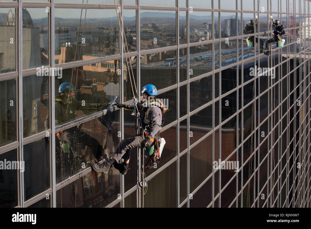 Abseiling Window Cleaners. Cleaning Windows at The Crowne Plaza in Nottingham City Centre Stock Photo