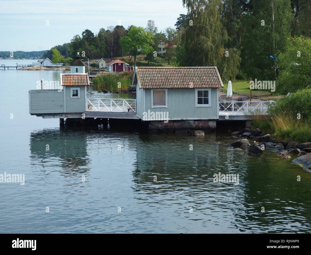 Wooden boat house and jetty on an island in the Stockholm Archipelago, Sweden - Stock Image