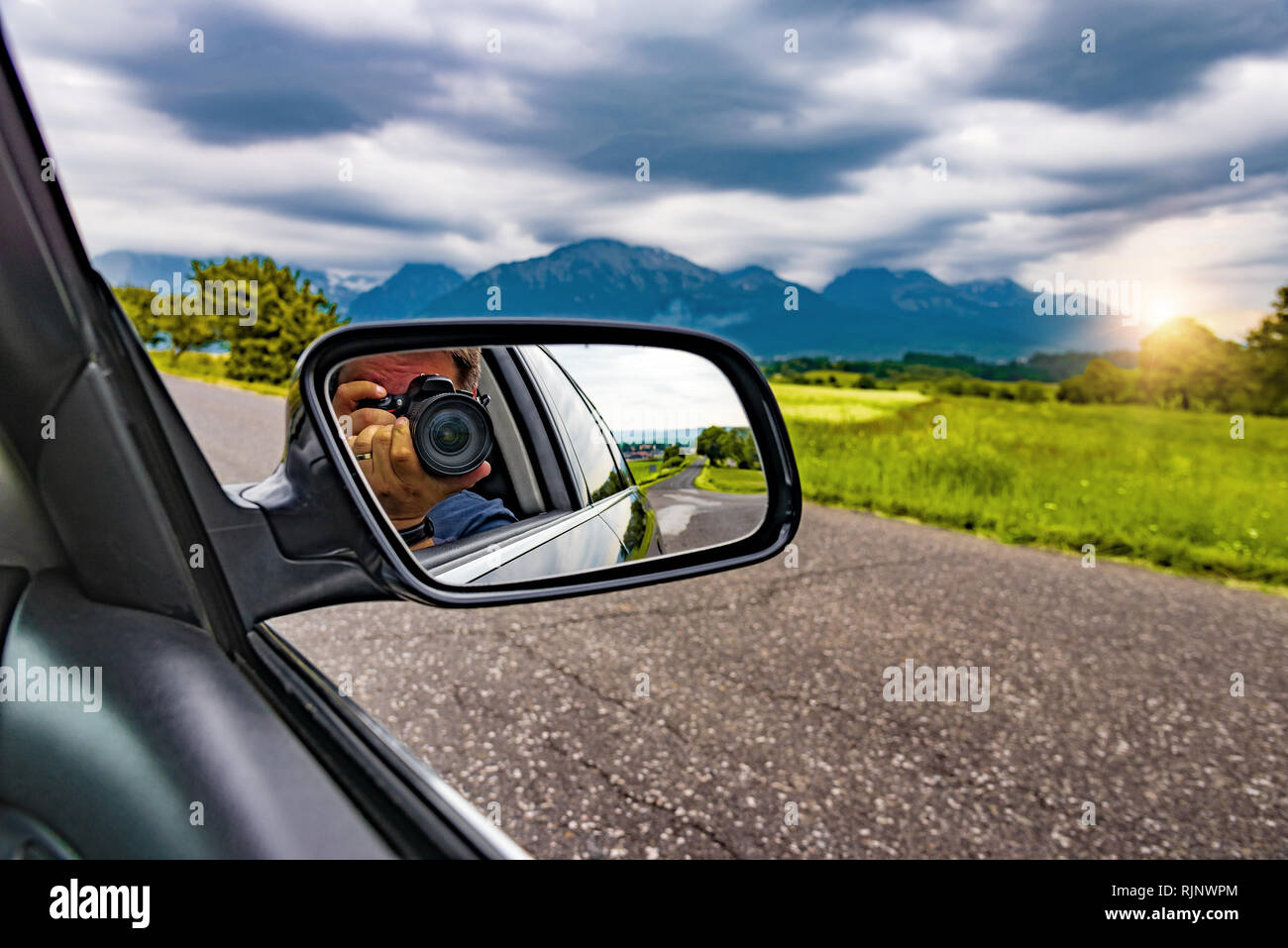 Reflection Of A Photographer With A Camera In The Rear View Mirror Of A Car In Nature Stock Photo Alamy