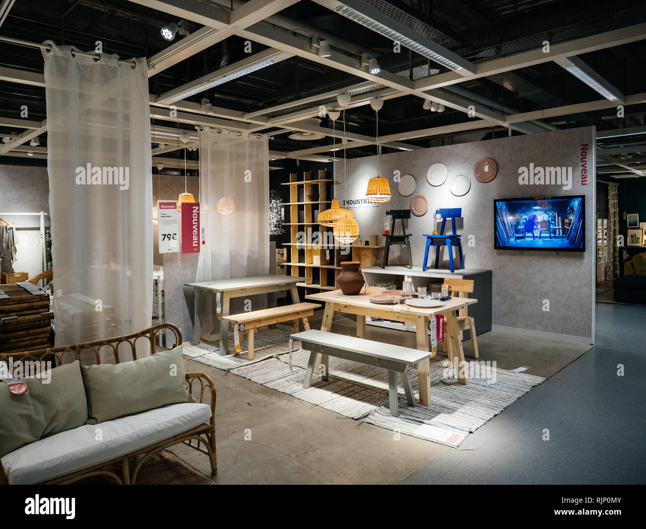 PARIS, FRANCE - JUN 7, 2018: View of stylish dining zone composed in furniture shop Ikea with multiple accessories and furniture - Stock Image