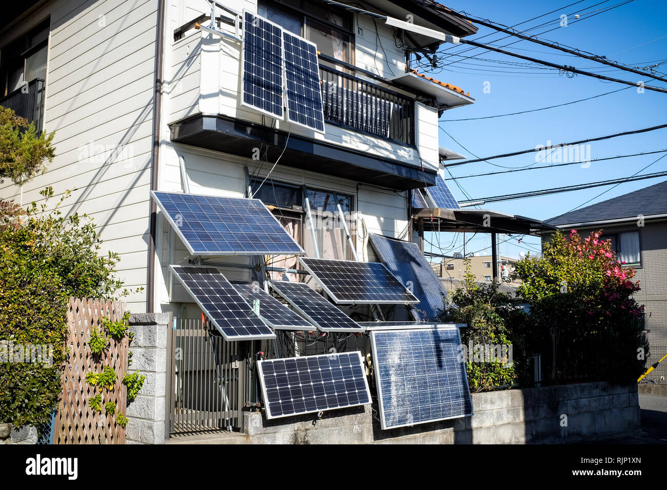 A house in Osaka, Japan, with lots of solar panels attached. It's highly unusual to see panels attached in this way. - Stock Image