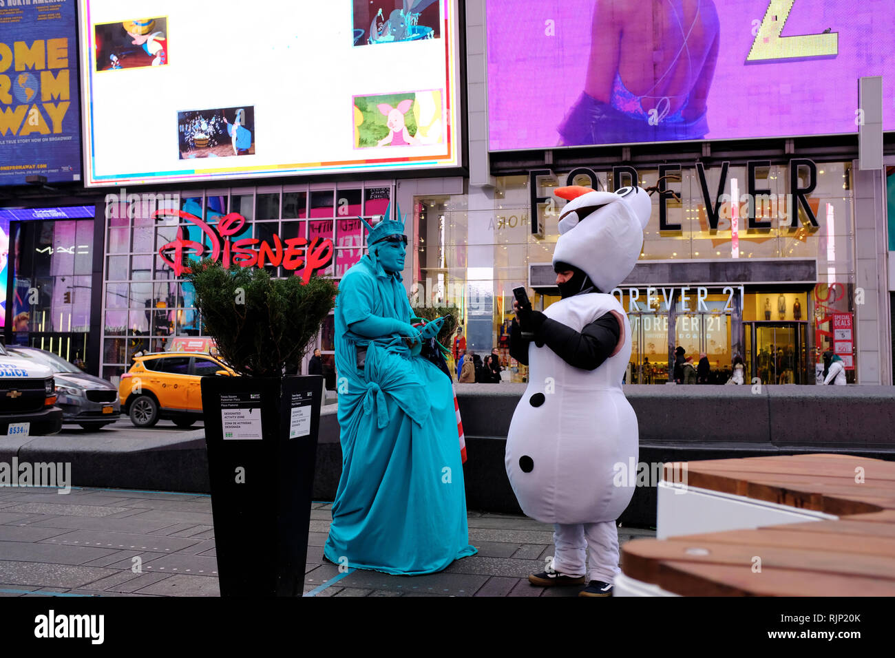 Costumed characters in Times Square waiting for tourist taking photos with them to earn tips.New York City.NY.USA - Stock Image