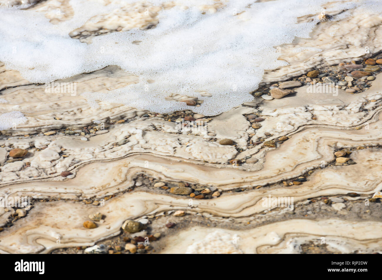 Close-up view of the Dead Sea shore seen from the Israeli border. - Stock Image
