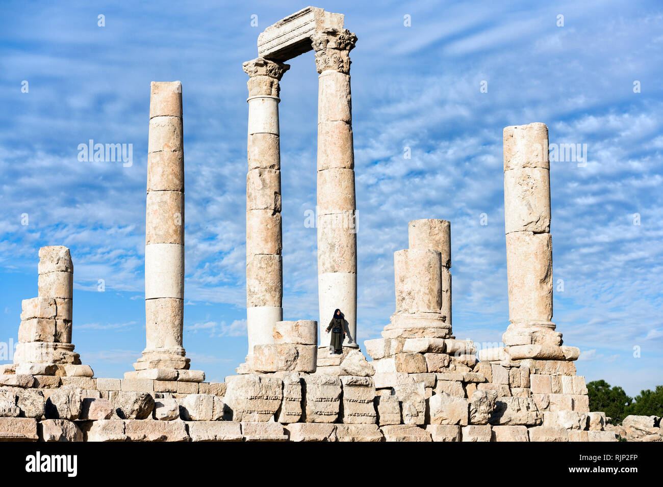 the latest cd49a 66230 A girl is posing for a picture in front of some magnificent columns in the  Amman Citadel, Jordan.
