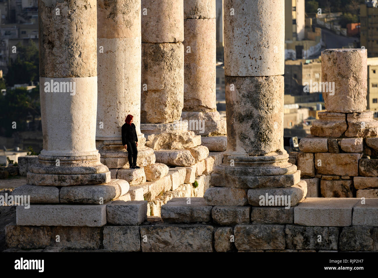 huge selection of e4d87 6f6d1 AMMAN - JORDAN - 12 JANUARY 2019. A girl is posing for a picture in front  of some magnificent columns in the Amman Citadel, Jordan. The Amman Citadel